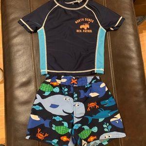 Boy's rashguard with swim trunks